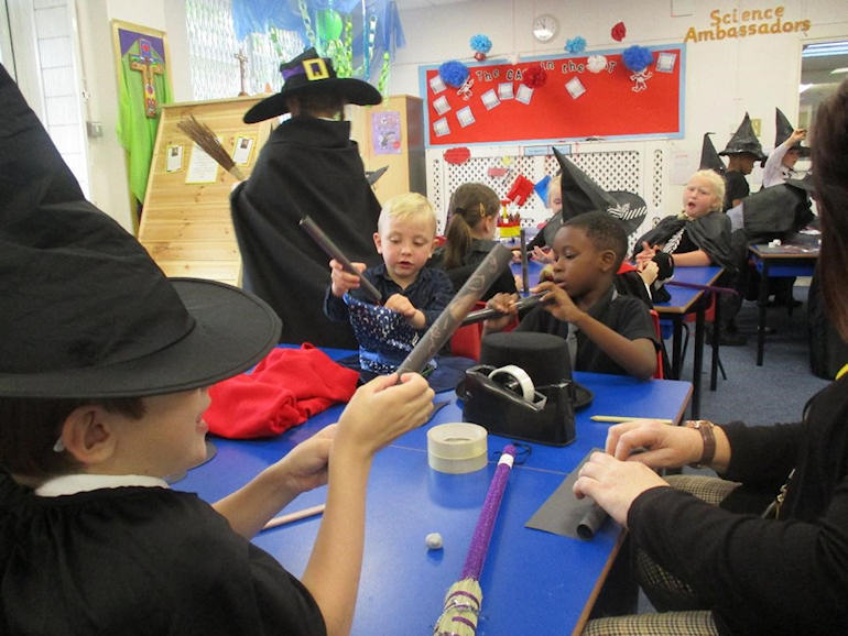 Children dressed as witches in Art Club