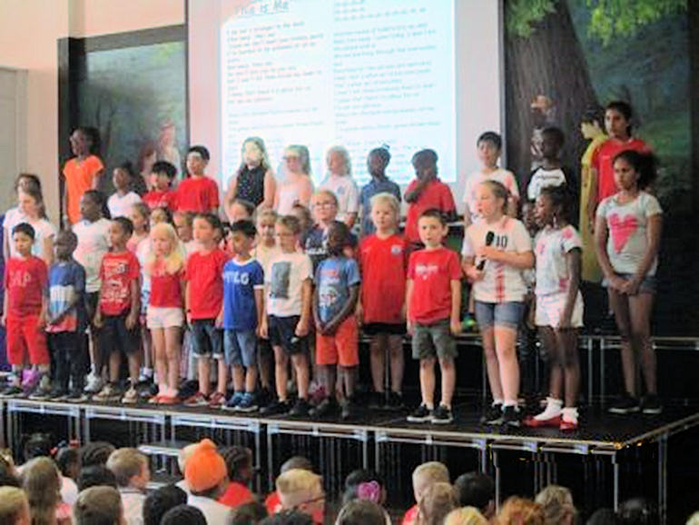 Choir singing in assembly