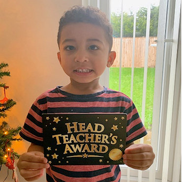 A child receiving his Headteacher's Award